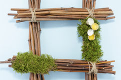 Easter frame with two raw quail eggs and empty blue field Royalty Free Stock Images