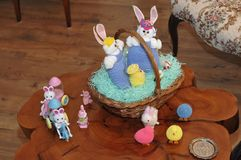 Easter Holiday Friends and Family. Easter friends having a get together on an old cypress log slice Stock Images