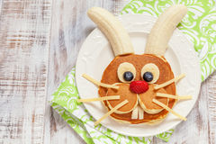 Easter funny bunny pancakes with fruits Stock Photos