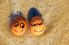 Easter funny eggs  on a beach Royalty Free Stock Images