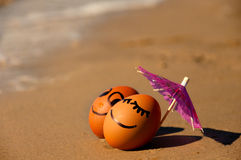 Easter funny eggs under umbrella on a beach Royalty Free Stock Image
