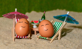 Easter funny eggs under umbrella Royalty Free Stock Image