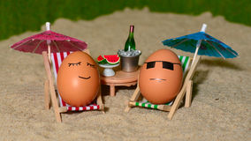 Easter funny eggs under umbrella Stock Photo