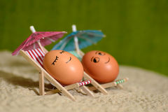 Easter funny eggs under umbrella Stock Image
