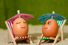 Easter funny eggs under umbrella Royalty Free Stock Photos