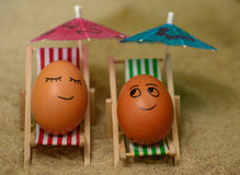 Easter funny eggs under umbrella Stock Images