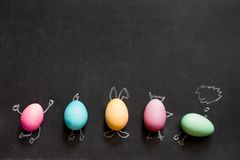 Easter funny painting eggs on blackboard abstract children`s background royalty free stock photo
