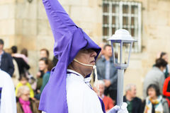 Easter in Galicia Spain. PONTEVEDRA, SPAIN - APRIL 2, 2015: An acolyte carrying a lantern, member of a religious brotherhood, hope to participate in a procession Stock Image