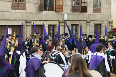 Easter in Galicia Spain. PONTEVEDRA, SPAIN - APRIL 2, 2015: Band instruments, wind and percussion, members of a religious brotherhood, parading in a procession Royalty Free Stock Image