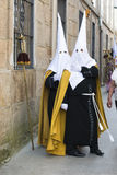 Easter in Galicia Spain. PONTEVEDRA, SPAIN - APRIL 2, 2015: A group of people belonging to a religious brotherhood, hope to ride on one of the Easter processions Stock Photo