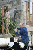 Easter in Galicia Spain. PONTEVEDRA, SPAIN - APRIL 2, 2015: A man belonging to a religious brotherhood, lights a lantern that is part of a religious image of Royalty Free Stock Photos