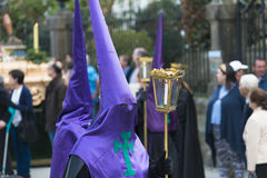 Easter in Galicia Spain. PONTEVEDRA, SPAIN - APRIL 2, 2015: A member of a religious brotherhood carrying a lantern parade in a procession in celebration of Stock Photos