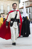 Easter in Galicia Spain. PONTEVEDRA, SPAIN - APRIL 2, 2015: A members of a religious brotherhood, walks to his companions, who hope to Participate in a Royalty Free Stock Photos