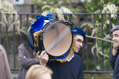 Easter in Galicia Spain. PONTEVEDRA, SPAIN - APRIL 2, 2015: A young man of a religious brotherhood, walks carrying a drum, before the start of a procession in Royalty Free Stock Photography