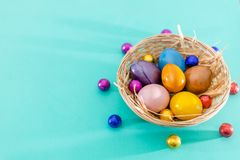 Easter garland with colorful easter eggs on green background. View from above, copy space. Easter decoration stock photos