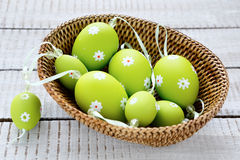 Easter garland of eggs in basket Stock Photo