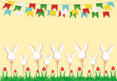 Easter. Garland of flags. Eggs made of paper on a stick with bow Royalty Free Stock Photos