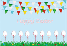 Easter. Garland of flags. Eggs made of paper on a stick with bow Royalty Free Stock Image