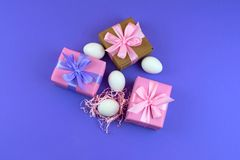 Easter gift Box set and white eggs. The view from the top Place for text. Background ultraviolet Royalty Free Stock Images