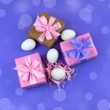 Easter gift Box set and white eggs. The view from the top Place for text. Background ultraviolet Stock Image