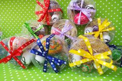 Easter gift boxes with colorful eggs stock images
