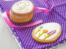 Easter gift. Homemade sugar cookies with floral ornament. Gingerbread cookies decorated in the shape of easter egg. Royalty Free Stock Photos