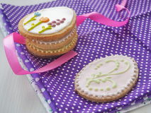 Easter gift. Homemade sugar cookies with floral ornament. Gingerbread cookies decorated in the shape of easter egg. Stock Photo