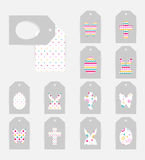 Easter gift tags. Template of Easter gift tags. Grey isolated layer on top individualized with a cut out silhouettes of egg, hare,  butterfly, cross. Bottom Stock Images