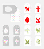 Easter gift tags. Template of Easter gift tags. Grey isolated layer on top individualized with a cut out silhouettes of egg, hare,  butterfly and cross. Bottom Stock Photo