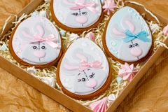 Easter gingerbread glazed cookies, eggs form with rabbit royalty free stock photo