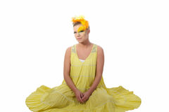 Easter girl. Picture of an easter girl dressed in yellow, with eggs in her hair, on a white, isolated background Stock Images