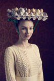 Easter girl with bizarre hat Stock Images