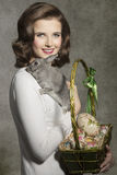 Easter girl with fluffy rabbit Royalty Free Stock Image