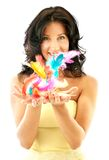 Easter girl. Happy girl in yellow corset throwing up easter feathers Royalty Free Stock Photo