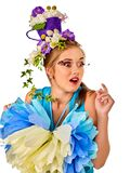 Woman in easter style holding rabbit and flowers hairstyle . Stock Photo
