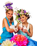 Easter girl together holding bunny. Women in holiday style. Easter girl together holding bunny. Women in holiday style celebrate take rabbits with flowers Stock Photo