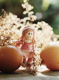 Easter girl walking among eggs Royalty Free Stock Images