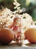 Easter girl walking among eggs Royalty Free Stock Images
