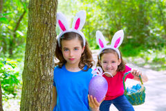 Easter girls playing on forest with bunny teeth gesture Royalty Free Stock Photos