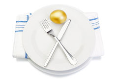 Easter golden egg on a plate. Royalty Free Stock Image