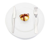 Easter golden egg on a plate. Royalty Free Stock Images