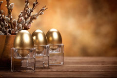 Easter - Golden eggs and catkin Royalty Free Stock Photo
