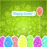Easter green background with ornament eggs Stock Image