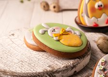Easter green cookie with painted easter bunny holding yellow strawberry royalty free stock images