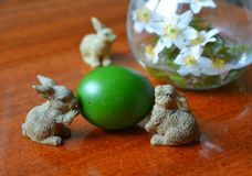Easter green egg and rabbits decor Royalty Free Stock Photos