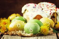 Easter green and yellow painted eggs, white apricot flowers, spring festive composition in rustic style, russian orthodox royalty free stock photos