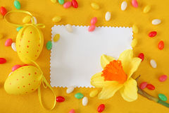 Easter greeting card. Yellow background stock photography