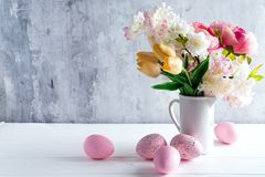 Easter greeting card backdrop with colorful spring flowers on white background. With copy space. For text stock images