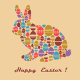 Easter greeting card with bunny and eggs. Vector Easter card with the inscription, rabbit and colored eggs on beige light background Royalty Free Stock Image