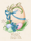 Easter greeting card with colorful eggs, flowers on beige background. Royalty Free Stock Photo
